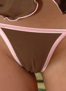 Brandi Teases With Her Tight Round Ass In A Tiny Thong - Picture 1