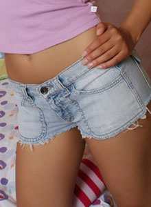 Donna Shows Off Her Tight Round Ass In Tiny Jean Cutoffs - Picture 1