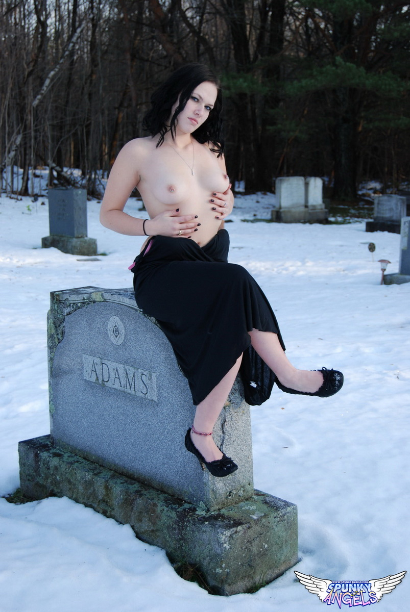 Perky babe Emily Love celebrates Halloween from the creepy cemetery in the snow