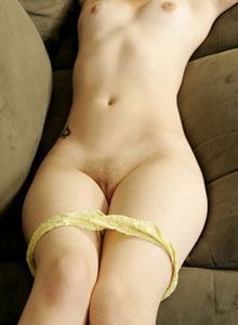 Emma Gets Naked On The Couch And Plays With Her Perky Tits - Picture 10