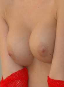 Lucky Shows Off Her Big Perky Tits In A Slutty Red Mesh Dress - Picture 9