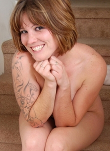 Curvy Tattooed Spunky Angel Misty Teases As She Strips Naked On The Stairs - Picture 9