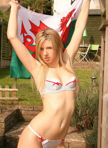 A Very Cute Ruby Loves To Show Off Her Tiny Perky Tits In Just A Flag - Picture 2